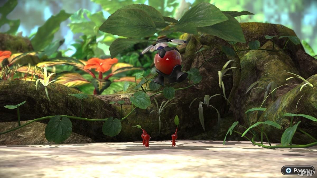 L'oignon de ces Pikmin rouges semble bloqué dans un arbre